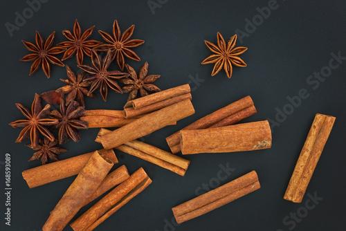 Fototapeta Sense of Spices cinnamon and star anise on black background whit copy space obraz