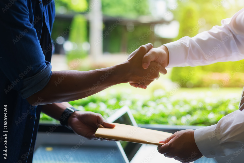 Fototapeta Image of a businessman negotiating a joint financial transaction. Successful negotiations