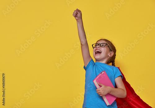 child plays superhero Fototapeta
