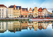 canvas print picture - Gent, Belgium. Sunrise in historical center of Ghent with medieval buildings of Korenlei, Graslei and castle of the counts (Gravensteen) reflecting in water of river Leie Flanders, Belgium.