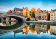 canvas print picture - Medieval cathedral and bridge over a canal in Ghent - Gent, Belgium