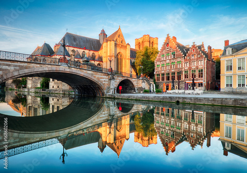 Obraz Medieval cathedral and bridge over a canal in Ghent - Gent, Belgium - fototapety do salonu