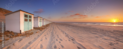 Row of beach huts at sunset, Texel island, The Netherlands