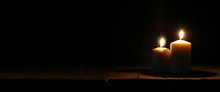 Burning Candles Over Old Wooden Table With Bokeh Lights.