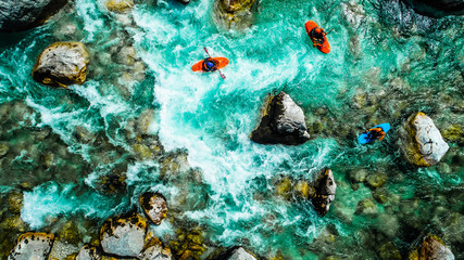 Fototapeta Emerald waters of Soca river, Slovenia, are the rafting paradise for adrenaline seekers and also nature lovers, aerial view.