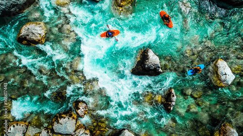 Emerald waters of Soca river, Slovenia, are the rafting paradise for adrenaline seekers and also nature lovers, aerial view.