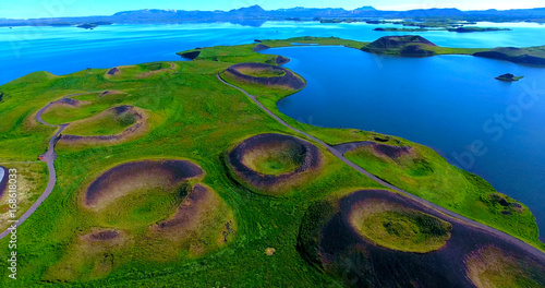 Obraz Volcanic Craters In Green Plains By Blue Water Bay - Myvatn, Iceland - fototapety do salonu