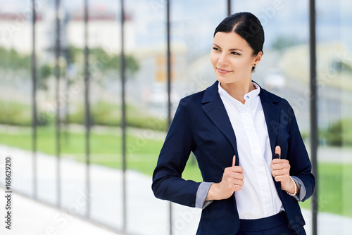 Portrait of self-confidence business woman next to the office Wallpaper Mural