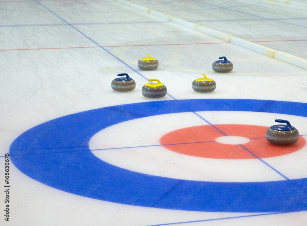 Fototapeta Curling stones equipment on the ice