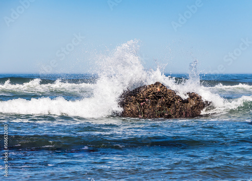 Ocean waves crash against rocks Lincoln City Oregon - Buy