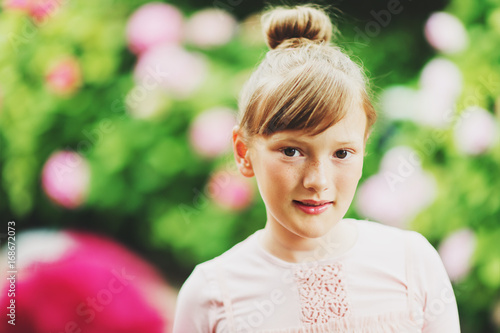 6b1245d4833a Outdoor portrait of pretty little girl playing with beautiful ...