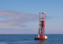 Red And White Buoy In Calm Water