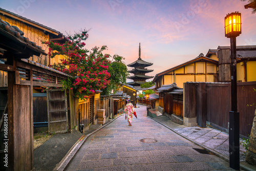 Acrylic Prints Kyoto Japanese girl in Yukata with red umbrella in old town Kyoto