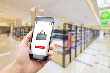 smart phone in modern supermarket