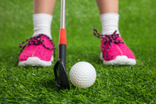 Closeup Of A Child Golfer With...
