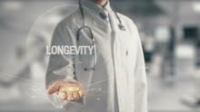 Doctor Holding In Hand Longevity