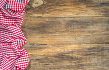 Rustic Red Checked Tablecloth On Wooden Table