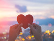 Leinwandbild Motiv Soft focus hand holding beautiful heart during sunset background. Happy, Love, Valentine's day idea, sign, symbol, concept.