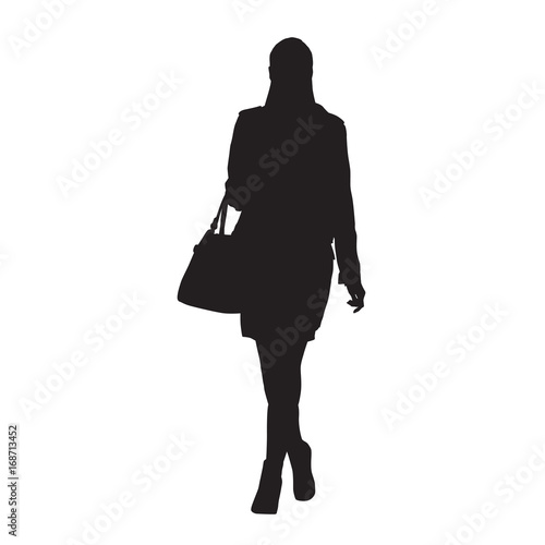 Woman Walking And Holding Handbag Or Purse In Her Hand