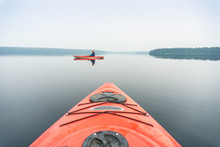 Portrait Of Woman In Kayak Taken From The Other One