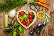Vegetables in the heart. Diet, healthy lifestyle on a rustic wooden background