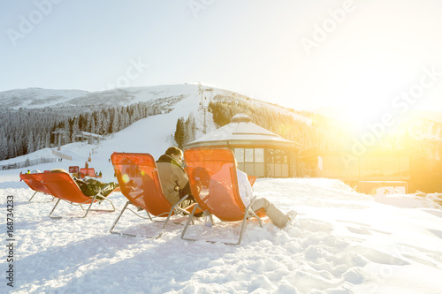 Poster Wintersporten CHOPOK, SLOVAKIA - JANUARY 12, 2017: Skiers and snowboarders taking a rest in chairs near apres ski bar at Chopok downhill, January 12, 2016 in Jasna - Slovakia