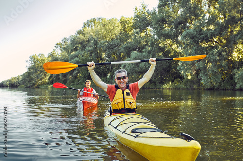 A canoe trip on the river in the summer. Fototapete