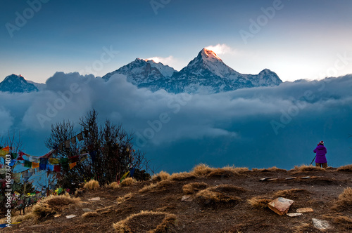 Canvas Prints Nepal Unidentified person taking photo of Annapurna mountain range at Poon Hill view point in Nepal. Poon Hill is a popular destination for trekkers in the Annapurna region of Nepal.