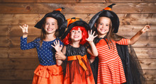 Funny Children Sister Twins Girl In Witch Costume In Halloween