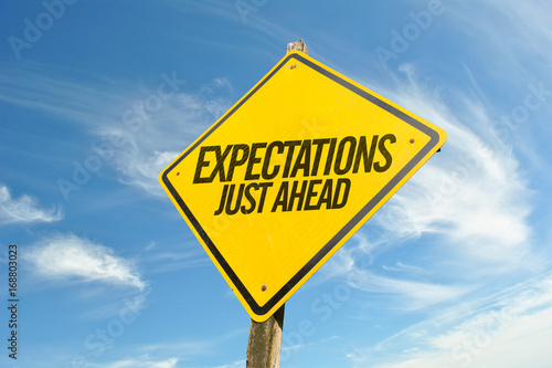 Expectations Just Ahead road sign Wallpaper Mural