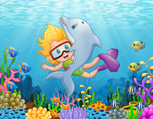 Little girl with dolphin swimming under the sea