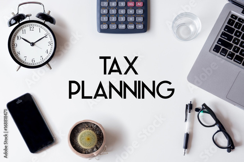 Tax Planning words written on white table with clock, smartphone, calculator, pe Canvas Print