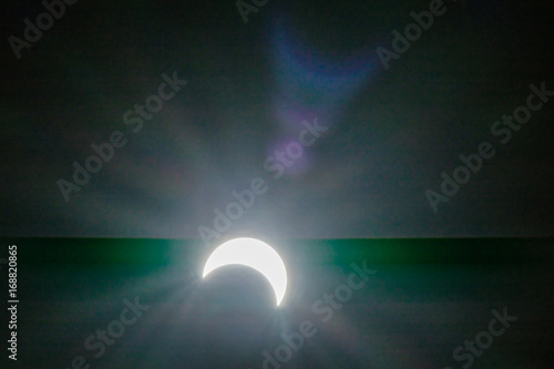 solar eclipse with glare backgrounds