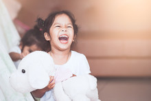 Happy Asian Child Girl Laughing And Having Fun To Play With Blanket And Sister In The House In Vintage Color Tone