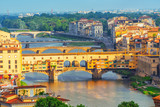 Beautiful landscape above, panorama on historical view of the Florence from  Piazzale Michelangelo point. Ponte Vecchio is a bridge in Florence, located at the narrowest point of the Arno River.