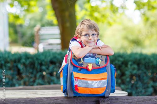 Fotografie, Obraz  little kid boy with school satchel on first day to school