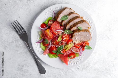 Valokuvatapetti Grilled pork fillet with salad,