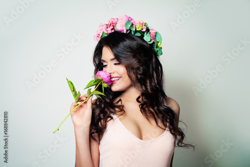 Happy Brunette Woman With Long Curly Hair And Spring Flowers Having Fun On Banner Background Buy This Stock Photo And Explore Similar Images At Adobe Stock Adobe Stock