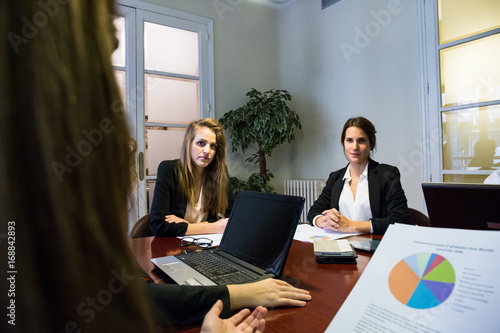 Young Colleagues On Meeting In Conference Room Working With Gadgets