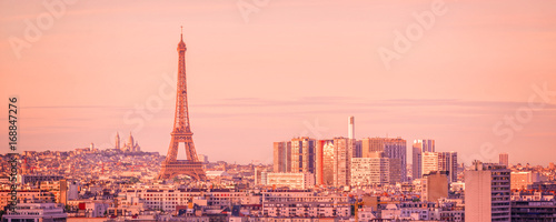 Poster Paris Panoramic skyline of Paris with the Eiffel tower at sunset, Montmartre in the background, France and Europe city travel concept