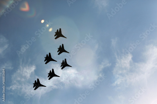 obraz dibond Military fighter jets during demonstration. Air show.