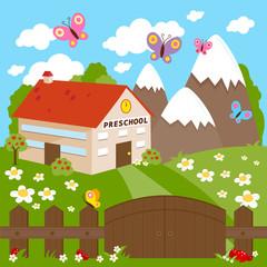 Fototapeta samoprzylepna Preschool building, meadow and wooden fence