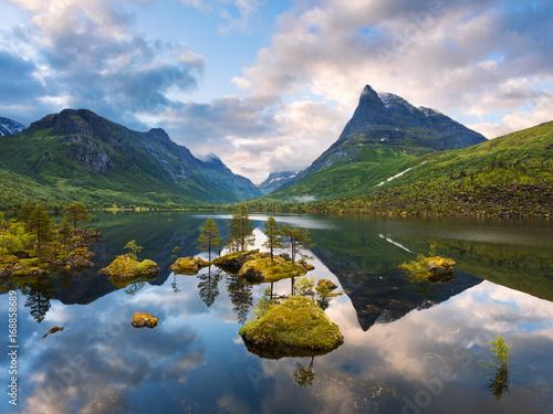 Montage in der Fensternische Skandinavien Mountain valley Innerdalen with a mirror lake in Norway