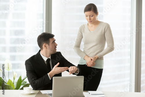 Irritated boss pointing on wristwatch, dissatisfied ceo demanding explanations o Wallpaper Mural