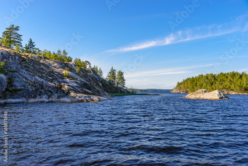 Valokuva  The rocky shores of the Ladoga skerries are covered with pine trees