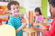 canvas print picture Kindergarten students smile when playing toy in playroom at preschool international,education concept