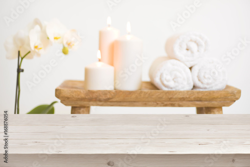 Fotobehang Spa Wooden table in front of blurred background of spa products