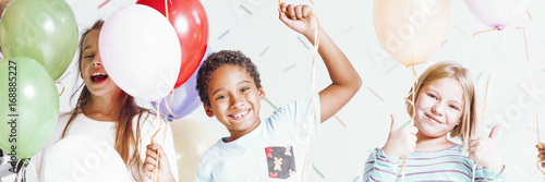 Photo  Kids with colorful balloons