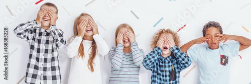 Fotografie, Obraz  Children with hands on their eyes