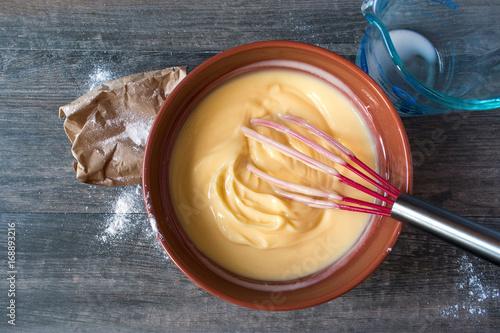 top view mixing ingredients for vanilla pudding Fototapeta